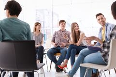 Young people having business training. In office stock image