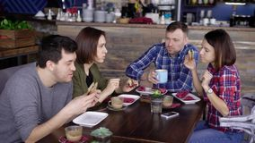 Young people having dinner together stock footage