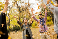 Young people having fun in the autumn park Stock Photos