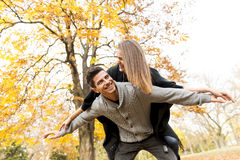 Young people having fun in the autumn park Stock Image