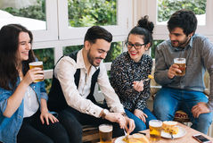 Young people having fun in a bar Stock Photos