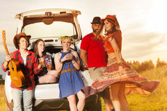 Young people having fun after a car trip Royalty Free Stock Image