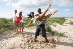 Young People Having Fun Dancing On Beach Stock Photos