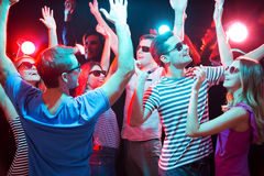 Young people having fun dancing Royalty Free Stock Images