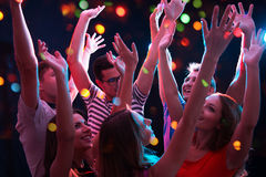 Young people having fun dancing Royalty Free Stock Photos
