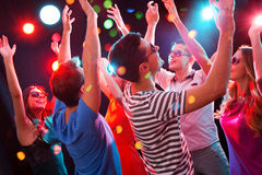 Young people having fun dancing Stock Images