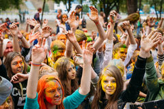 Young people having fun and dancing together at Holi color festi Stock Photography