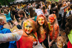 Young people having fun and dancing together at Holi color festi Royalty Free Stock Image