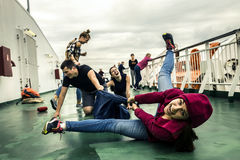 Young people having fun on the deck Stock Image