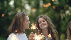 Young people at celebration party with sparklers stock footage