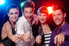 Young people having fun in nightclub. Attractive young people having fun in nightclub, smiling, drinking champagne Stock Photos