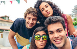 Young people having fun in summer party outdoors Stock Photo