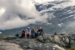 Young people are having fun on the top of mountain, Trollstigen, Stock Photo