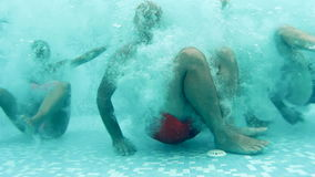 Young people having fun under water stock video