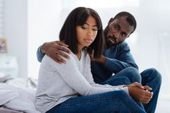 Young people having problems in their relationships. Personal problems. Beautiful young couple looking unhappy while having difficulties in their close Stock Photos