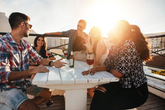 Young people having rooftop party in evening. Stock Photos
