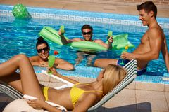Young people having summer fun in pool Royalty Free Stock Photos