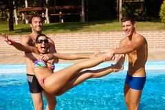Young people having summer fun by pool Stock Photography