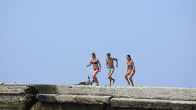 Young people having summer fun on sea stock video footage