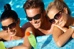Young people having summer fun in water Stock Photos