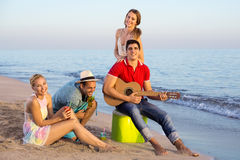 Young People Having their Vacation at the Beach Royalty Free Stock Images