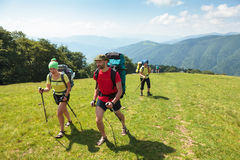 Young people are hiking in Carpathian mountains Royalty Free Stock Photography