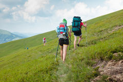 Young people are hiking in Carpathian mountains Stock Photos
