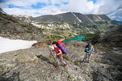 Young people are hiking in highlands of Altai mountains, Russia Royalty Free Stock Image