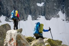 Young people are hiking in highlands of Altai mountains, Russia Royalty Free Stock Photography