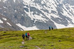 Young people are hiking in highlands of Altai mountains, Russia Royalty Free Stock Images