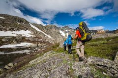 Young people are hiking in highlands of Altai mountains, Russia Stock Photo
