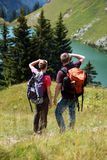 Young people hiking in the mountains. Male and female hikers in the German Alps near Oberstdorf searching the right trail stock images