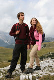 Young people hiking in the mountains Stock Photo