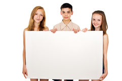 Young people hold advertising poster Stock Photos