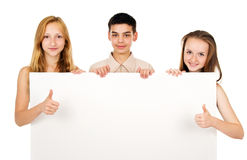 Young people holding a blank banner Stock Images