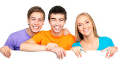 Young people holding a blank white card board Stock Photos