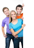 Young people holding a blank white card board Stock Image