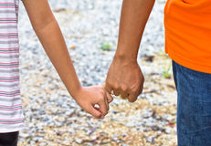 Young people holding hands Royalty Free Stock Image