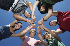 Young People Holding Hands In Circle royalty free stock images