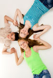 Young people holding hands Stock Photo