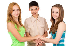 Young people holding hands Royalty Free Stock Photo