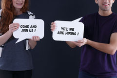 Young people holding speech balloons. With short text Royalty Free Stock Image