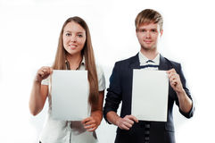 Young people holding two blank billboards Stock Images