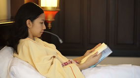 Young people at home, leisure and relax, portrait of beautiful Asian girl reading book stock video footage