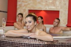 Young people in the hot tub Stock Photo