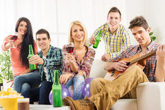 Young People At House Party Toast Royalty Free Stock Image