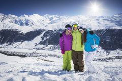 Young people hugging and posing ski resort Royalty Free Stock Photos