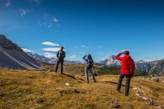 Young people in italien dolomites, loving nature and climbing, beautiful view scenery tre cime di lavaredo Stock Photo