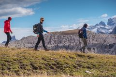 Young people in italien dolomites, loving nature and climbing, beautiful view scenery tre cime di lavaredo Royalty Free Stock Image