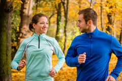 Young people jogging together in nature Royalty Free Stock Photo